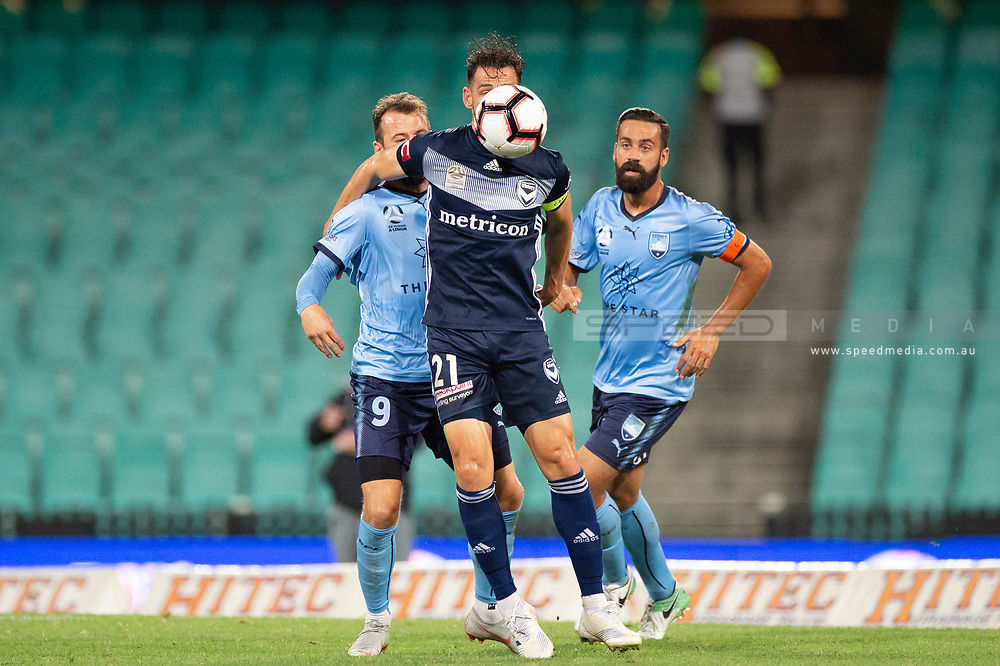 SYDNEY, AUSTRALIA - APRIL 06: Melbourne Victory midfielder Carl Valeri (21) and Sydney FC forward Adam Le Fondre (9) fight for the ball at round 24 of the Hyundai A-League Soccer between Sydney FC and Melbourne Victory on April 06, 2019, at The Sydney Cricket Ground in Sydney, Australia. (Photo by Speed Media/Icon Sportswire)