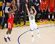 Golden State Warriors guard Stephen Curry (30) closes out on Houston Rockets guard James Harden (13) during a shot attempt during Game 6 of the Western Conference Finals at Oracle Arena in Oakland, Calif., on May 26, 2018. (Stan Olszewski/Special to S.F. Examiner)