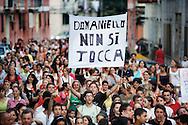 Napoli, Italia - 6 luglio 2010. Circa 500 abitanti del quartiere di Secondigliano (Scampia) hanno partecipato ad una fiaccolata per manifestare il loro disseno nei confronti del trasferimento del prete anti-camorra don Aniello Manganiello..Ph. Roberto Salomone Ag. Controluce.ITALY - 500 residents of Secondigliano district in Naples took part to the torch rally to protest against the decision to remove anti-camorra mafia organisation priest don Aniello Manganiello from his church in the Secondigliano district on July 6, 2010.