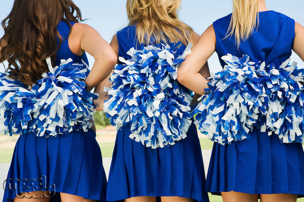 Cheerleaders holding pom-poms rear view (mid section) (close-up)