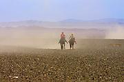 GOBI DESERT, MONGOLIA..08/26/2001.Bayangovi. Local Naadam festival. Finish of a horse race over 30 kilometers..(Photo by Heimo Aga).