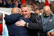 Brentford Manager / Head Coach Dean Smith and Queens Park Rangers head coach Ian Holloway shake hands before kick off during the EFL Sky Bet Championship match between Brentford and Queens Park Rangers at Griffin Park, London, England on 22 April 2017. Photo by Andy Walter.