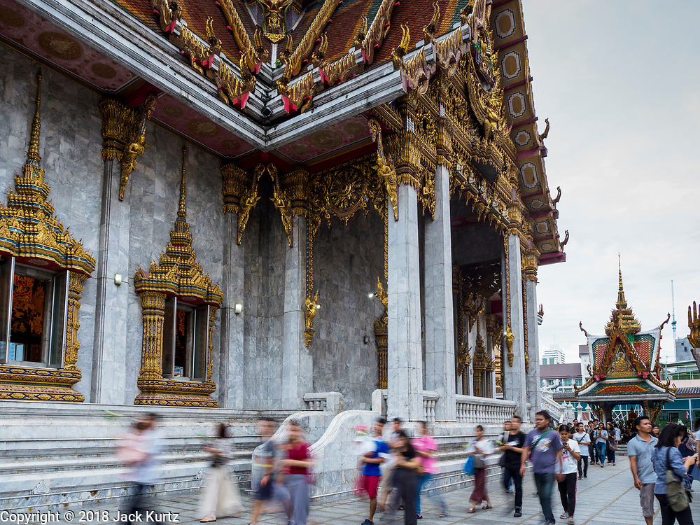 29 MAY 2018 - BANGKOK, THAILAND: People participate in a procession around the prayer hall during Vesak observances at Wat Hua Lamphong in Bangkok. Vesak is the Buddha's birthday, and one of the most important holy days in the Theravada Buddhist religion. Many Thais visit their local temples for Vesak and rededicate themselves to the Dharma, listen to talks about Buddhism and make merit by bringing flowers to the temple.       PHOTO BY JACK KURTZ