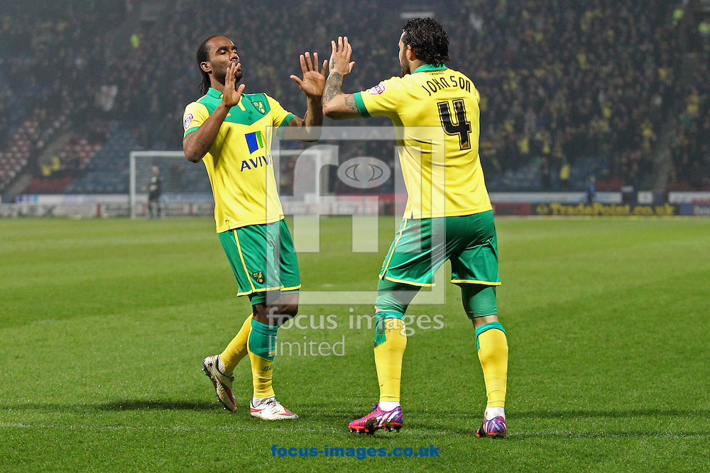 Bradley Johnson of Norwich puts the ball in the net with his hand and celebrates but the goal is disallowed by Referee Nigel Miller after consulting with Assistant Referee Lisa Rashid during the Sky Bet Championship match at the John Smiths Stadium, Huddersfield<br /> Picture by Paul Chesterton/Focus Images Ltd +44 7904 640267<br /> 17/03/2015