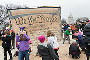 Demonstrators sign a giant petition during the Women's March on Washington in protest to President Donald Trump January 21, 2017 in Washington, DC. More than 500,000 people crammed the National Mall in a peaceful and festival rally in a rebuke of the new president.