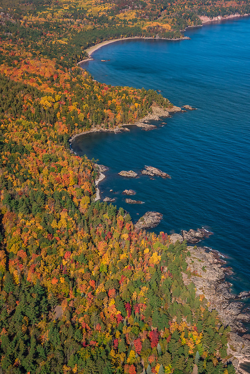Aerial photography of  the rugged Lake Superior shoreline at Wetmore Landing north of Marquette, Michigan during fall color season.