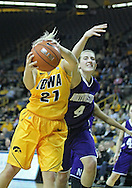 December 30, 2011: Iowa Hawkeyes guard Melissa Dixon (21) grabs a rebound as Northwestern Wildcats forward Kendall Hackney (4) fights for it during the NCAA women's basketball game between the Northwestern Wildcats and the Iowa Hawkeyes at Carver-Hawkeye Arena in Iowa City, Iowa on Wednesday, December 30, 2011.