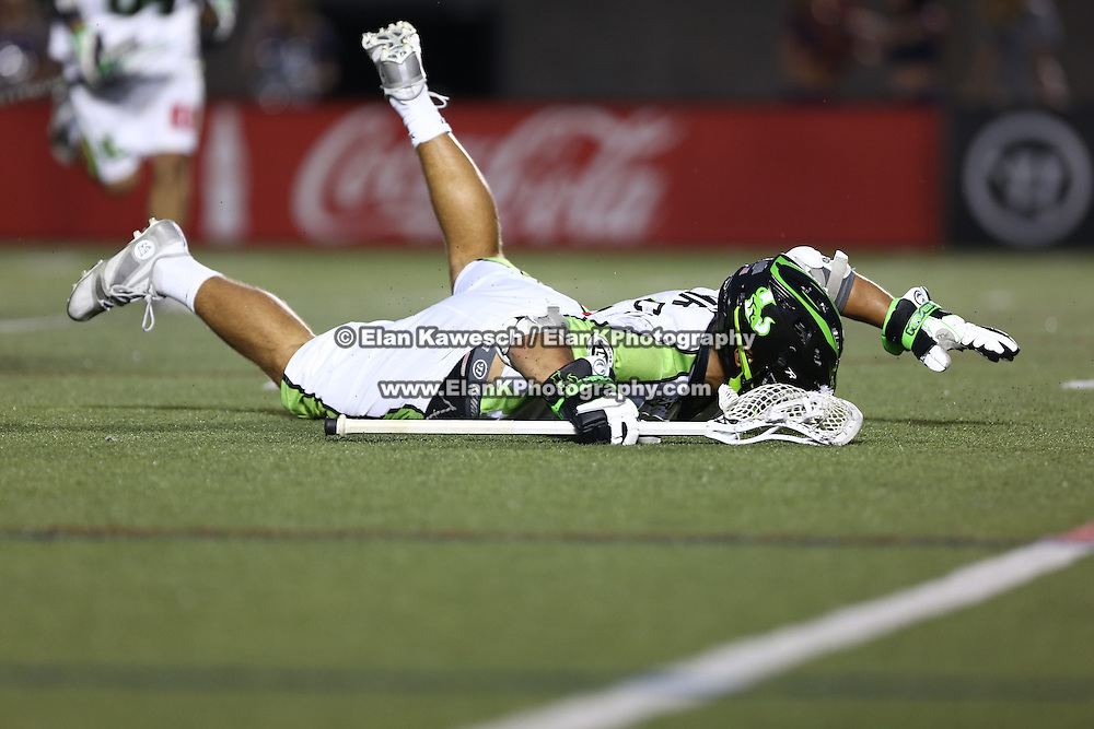 JoJo Marasco #1 of the New York Lizards falls to the ground after scoring the game winning goal in overtime during the game at Harvard Stadium on July 19, 2014 in Boston, Massachusetts. (Photo by Elan Kawesch)