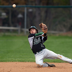 Staff photos by Tom Kelly IV<br /> Ridley shortstop Jake Hoffman (27) makes a sliding stop on a hard hit ground ball but couldn't get the throw to first in time during the Ridley at Strath Haven baseball game on Thursday afternoon.