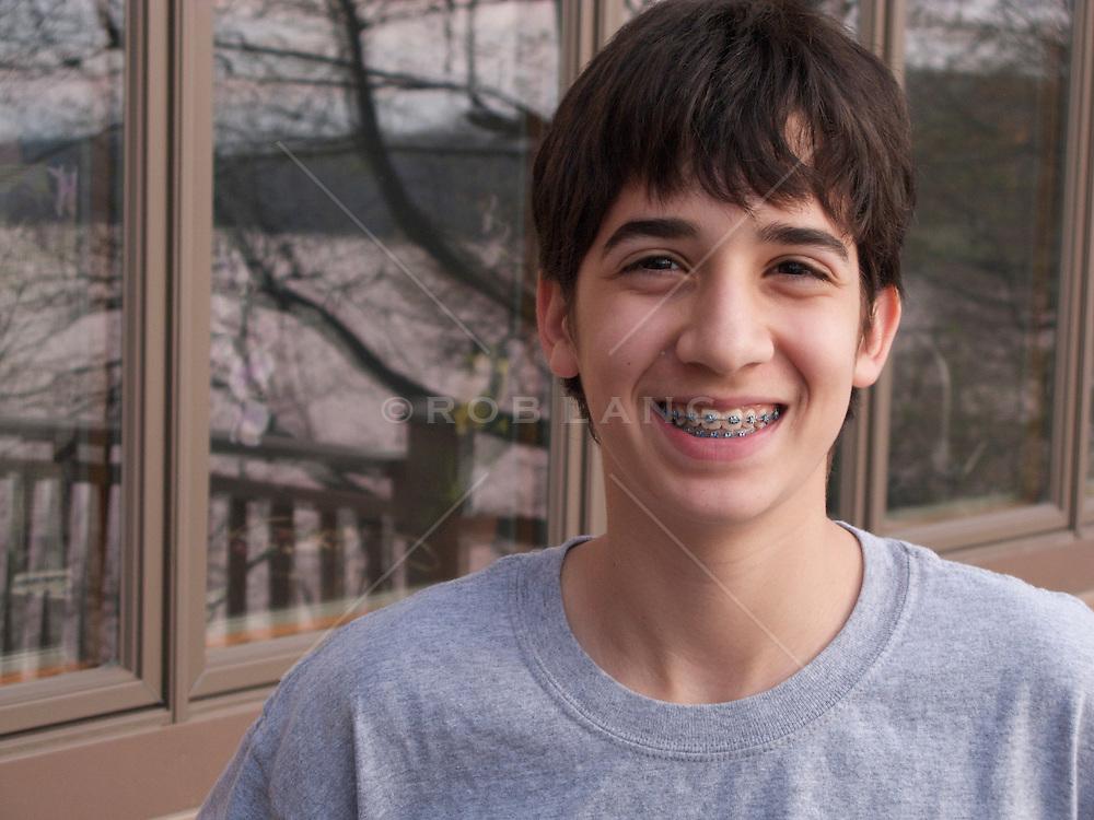 teenage boy wearing braces and smiling