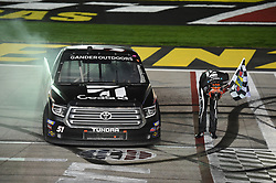 March 1, 2019 - Las Vegas, NV, U.S. - LAS VEGAS, NV - MARCH 01: Kyle Busch (51) KBM Toyota Tundra bows with the Sunoco checkered flag and waves it over his truck to celebrate the race win during the NASCAR Gander Outdoors Truck Series Strat 200 on March 01, 2019, at Las Vegas Motor Speedway in Las Vegas, NV. (Photo by Chris Williams/Icon Sportswire) (Credit Image: © Chris Williams/Icon SMI via ZUMA Press)