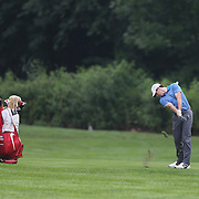 Rory McIlroy watched by his caddie caddie JP Fitzgerald during the ProAm at The Barclays Golf Tournament at The Ridgewood Country Club, Paramus, New Jersey, USA. USA. 20th August 2014. Photo Tim Clayton