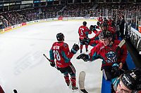 KELOWNA, CANADA - MARCH 16: Cayde Augustine #5 and Leif Mattson #28 of the Kelowna Rockets fist bump the bench to celebrate a goal against the Vancouver Giants  on March 16, 2019 at Prospera Place in Kelowna, British Columbia, Canada.  (Photo by Marissa Baecker/Shoot the Breeze)