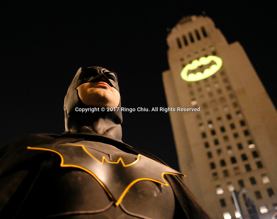 A man dressed as Batman as the Bat-signal is projected onto Los Angles City Hall during a tribute to pop-culture icon Adam West in Los Angeles, June15, 2017.(Photo by Ringo Chiu)<br /> <br /> Usage Notes: This content is intended for editorial use only. For other uses, additional clearances may be required.
