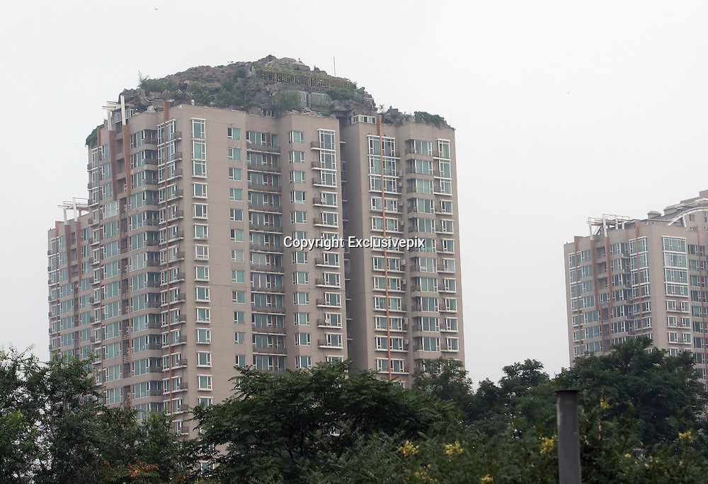 BEIJING, CHINA - AUGUST 12: (CHINA OUT) <br /> <br /> A Model Built On A Building <br /> <br /> An illegally built model of a Hill has been built on the top of a building in Beijing,china<br /> ©Exclusivepix