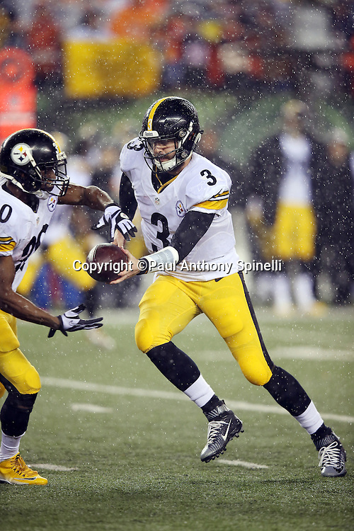 Pittsburgh Steelers quarterback Landry Jones (3) hands off the ball to Pittsburgh Steelers running back Jordan Todman (30) on a running play during the NFL AFC Wild Card playoff football game against the Cincinnati Bengals on Saturday, Jan. 9, 2016 in Cincinnati. The Steelers won the game 18-16. (©Paul Anthony Spinelli)