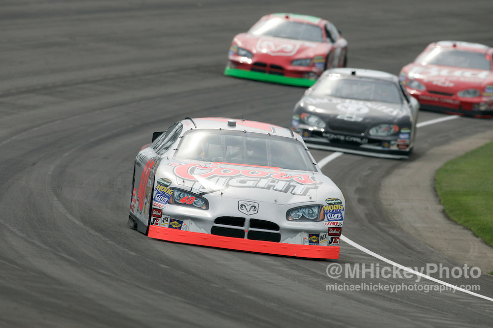 Sterling Marlin leads a pack of cars during practice for the Allstate 400 at the Brickyard.