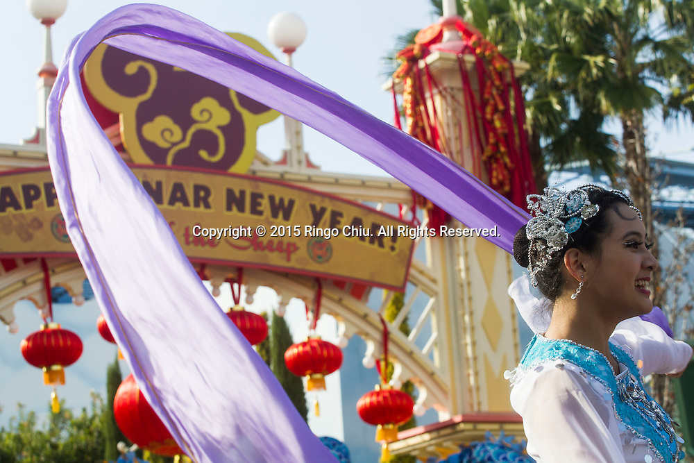 A dancer performs at the Paradise Garden in Disney California Adventure Park during the Happy Lunar New Year Celebration on Saturday February 21, 2015 in Anaheim, California. (Photo by Ringo Chiu/PHOTOFORMULA.com)