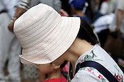 female person side view wearing a casual fashion style soft hat