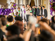 10 JANUARY 2015 - BANGKOK, THAILAND:  General PRAYUTH CHAN-OCHA, the Prime Minister of Thailand, greets the public while he walks into a cultural performance during National Children's Day celebrations at Government House in Bangkok. National Children's Day falls on the second Saturday of the year. Thai government agencies sponsor child friendly events and the military usually opens army bases to children, who come to play on tanks and artillery pieces. This year Thai Prime Minister General Prayuth Chan-ocha, hosted several events at Government House, the Prime Minister's office.   PHOTO BY JACK KURTZ