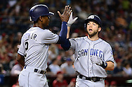 PHOENIX, AZ - JULY 06:  Ryan Schimpf #11 of the San Diego Padres is greeted by Melvin Upton Jr. #2 after hitting a two run home run during the fourth inning against the Arizona Diamondbacks at Chase Field on July 6, 2016 in Phoenix, Arizona.  (Photo by Jennifer Stewart/Getty Images)
