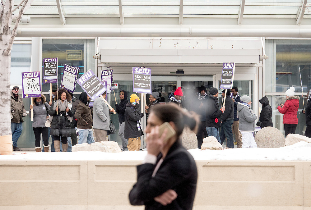 Twin Cities janitors represented by Service Employees International Union, as well as some supporters, picket for a wage increase at Minneapolis-St. Paul International Airport's Terminal 1 February 17, 2016.  The union is asking for $15 for both full and part-time workers.