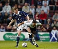 Photo Aidan Ellis.<br />Scotland v New Zealand (intl friendly at Tynecastle)<br />27/05/2003.<br />Scotland's Kevin Kyle and Kiwi Vaughan Covney