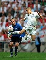 Photo: Tom Dulat.<br /> England v Estonia. UEFA European Championships Qualifying. 13/10/2007.<br /> Joe Cole of England jumps to get the ball, Player of Estonia Aleksandr Dimitrijev