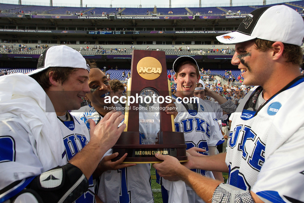 31 May 2010: Duke Blue Devils midfielder Sam Spillane (5) and midfielder Justin Turri (12) celebrate after a 5-6 win over the Notre Dame Fighting Irish and becoming the National Champion at M&T Bank Stadium in Baltimore, MD.