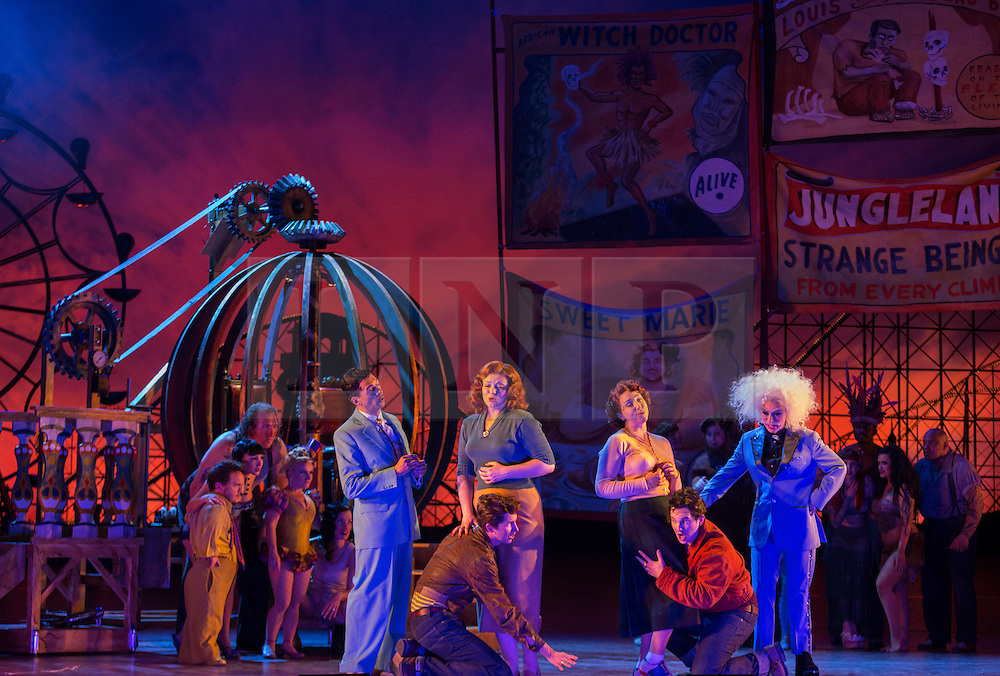 """© Licensed to London News Pictures. 14/05/2014. London, England. L-R: Randall Williams as Don Alfonso, Randall Bills as Ferrando, Kate Valentine as Fiordiligi, Christine Rice as Dorabella, Marcus Farnsworth as Guglielmo and Mary Bevan as Despina (in disguise as doctor). Dress rehearsal of the Wolfgang Amadeus Mozart opera """"Così fan tutte"""" at the London Coliseum. A new ENO production of Mozart's dark comedy set in the world of a 1950's Coney Island funfair. With Kate Valentine as Fiordiligi, Christine Rice as Dorabella, Marcus Farnsworth as Guglielmo, Randall Bills as Ferrando, Mary Bevan as Despina and Roderick Williams as Don Alfonso. Directed by Phelim McDermott, Conductor: Ryan Wigglesworth. Co-produced by the English National Opera and the Metropolitan Opera, New York. In collaboration with Improbable. 12 performances from 16 May to 6 July 2014. Photo credit: Bettina Strenske/LNP"""