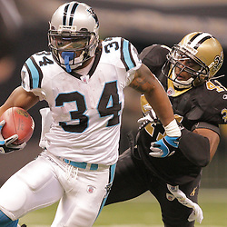 2008 December, 28: New Orleans Saints cornerback Mike McKenzie (34) runs away from New Orleans Saints safety Roman Harper (41) during a week 17 game between NFC South divisional rivals the Carolina Panthers and the New Orleans Saints at the Louisiana Superdome in New Orleans, LA.