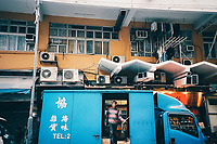 A man delivers goods in the Mongkok neighborhood of Kowloon in Hong Kong.