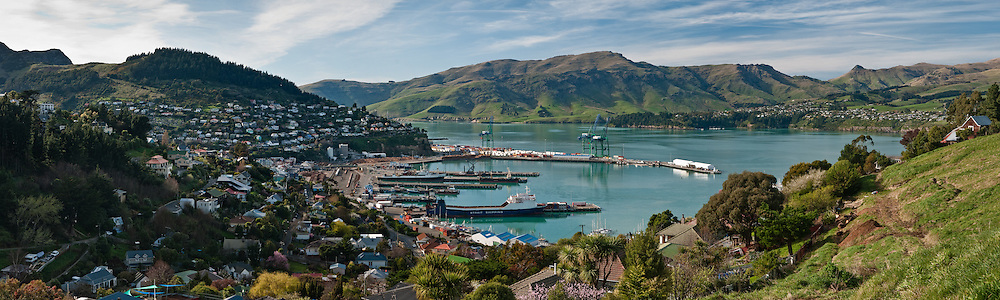 Panoramic view over the jade green waters of Lyttelton harbour, showing docks and township as seen from Fitzroy Head
