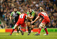 Picture by Andrew Tobin/Focus Images Ltd. 07710 761829. .27/12/11. Joe Marler (1) of Harlequins is tackled by Carlos Nieto (3) of Saracens and Steve Borthwick (4) of Saracens during the Aviva Premiership match between Harlequins and Saracens at Twickenham Stadium, London.