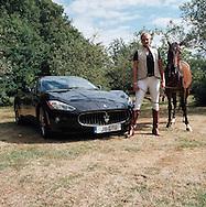 Jodie Kidd with Maserati and Ferrari