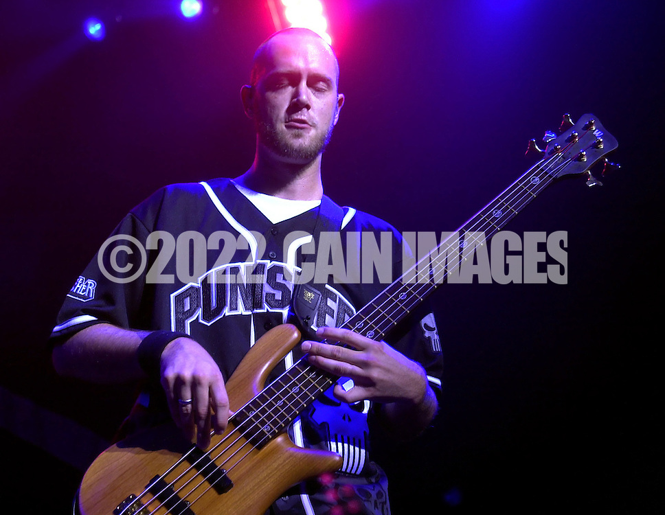 P-Nut, aka Aaron Wills of 311, performs on stage during the Sprite Liquid Mix Tour at the Tweeter Center, Tuesday, August 27, 2002, in Camden, New Jersey. The Sprite Liquid Mix Tour features a fusion of music, street sports, artistic demonstrations, fashion and entertainment. Attendees can participate in full-court basketball, view street-type skaters, BMX bikers, a canvas featuring local urban graffiti artists, an urban fashion show, and a music mixing station. (Photo by William Thomas Cain/photodx.com)