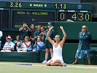 WIMBLEDON CHAMPIONSHIPS 03/07/04 DAY 12<br />A NEW CHAMPION IS BORN AND MARIA SHARAPOVA (RUS) SINKS TO HER KNEES AS SHE WINS  LADIES FINAL<br />Photo Roger Parker Fotosports International