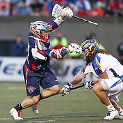 Kevin Buchanan #27 of the Boston Cannons tries to get past Josh Hawkins #3 of the Charlotte Hounds during the game at Harvard Stadium on May 17, 2014 in Boston, Massachuttes. (Photo by Elan Kawesch)