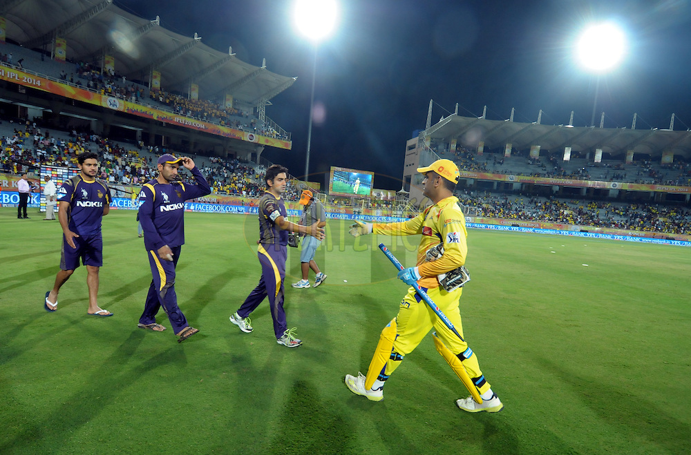 MS Dhoni captain of The Chennai Superkings shake hands with KKR players after match 21 of the Pepsi Indian Premier League Season 2014 between the Chennai Superkings and the Kolkata Knight Riders  held at the JSCA International Cricket Stadium, Ranch, India on the 2nd May  2014<br /> <br /> Photo by Arjun Panwar / IPL / SPORTZPICS<br /> <br /> <br /> <br /> Image use subject to terms and conditions which can be found here:  http://sportzpics.photoshelter.com/gallery/Pepsi-IPL-Image-terms-and-conditions/G00004VW1IVJ.gB0/C0000TScjhBM6ikg