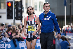 © Licensed to London News Pictures . 22/05/2016 . Manchester , UK . First British men's runner to finish , RICHARD GOODMAN . The Great Manchester Run in Manchester City Centre . Photo credit : Joel Goodman/LNP