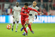 Bayern Munich midfielder Serge Gnabry (22) battles for possession with Liverpool defender Joel Matip (32) during the Champions League match between Bayern Munich and Liverpool at the Allianz Arena, Munich, Germany, on 13 March 2019.