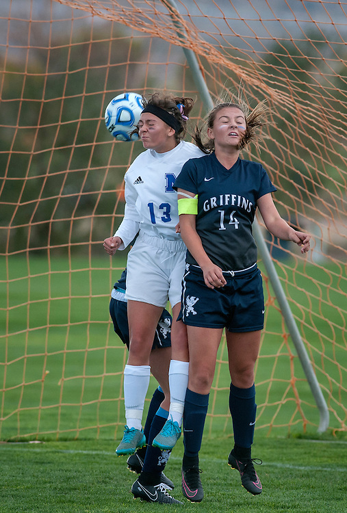em110316m/jnorth/sports/St. Michael's Maya Chavez, left, and Santa Fe Prep's Ariane Talou try to head the ball during their state tournament playoff game. The game was played in Bernalillo Thursday November 3, 2016.  St. Michael's won 3-2. (Eddie Moore/Albuquerque Journal