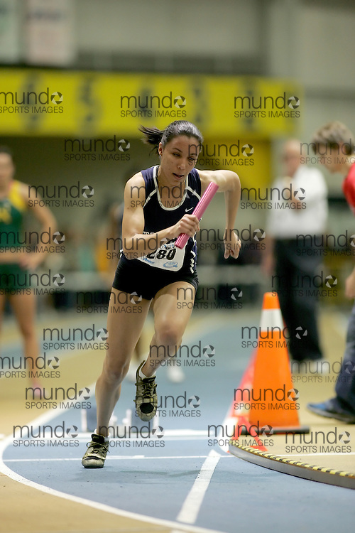 (Windsor, Ontario---13 March 2010) Alicia Brown of University of Toronto   competes in the women's 4x200m relay final at the 2010 Canadian Interuniversity Sport Track and Field Championships at the St. Denis Center. Photograph copyright Sean Burges/Mundo Sport Images. www.mundosportimages.com