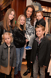 JULIE BRANGSTRUP and her children (L_R) MINI, LOTUS, JAGGER, CASH and COLUMBUS (holding) at the 4th birthday party for Amadeus Becker, son of Boris & Lilly Becker held at Ralph Lauren, 143 New Bond Street, London on 9th February 2014.