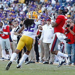 November 17, 2012; Baton Rouge, LA, USA; Ole Miss Rebels wide receiver Donte Moncrief (12) catches a pass over LSU Tigers cornerback Jalen Collins (32) during the first half of a game at Tiger Stadium.  Mandatory Credit: Derick E. Hingle-US PRESSWIRE