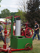 Antique steam tractors (steam water pump) are on display the Rock River Thresheree near Edgerton, Wisconsin. 2 Sept 2013