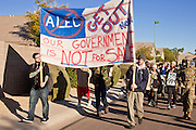 30 NOVEMBER 2011 - PHOENIX, AZ:    Anti-ALEC protesters march through a residential neighborhood to the Westin Kierland Resort and Spa in Phoenix Wednesday. About 300 people picketed the American Legislative Exchange Council (ALEC) conference at the Westin Kierland Resort and Spa in Phoenix, AZ, Wednesday. The protesters claim ALEC, a conservative think tank, violates its tax exempt status by engaging in lobbying, a charge ALEC officials deny. Many conservative pieces of legislation, like Arizona's anti-immigration bill SB1070, originate with ALEC conferences (SB 1070 originated at an ALEC conference several years ago). Many of the protesters are also members of the Occupy movement. PHOTO BY JACK KURTZ