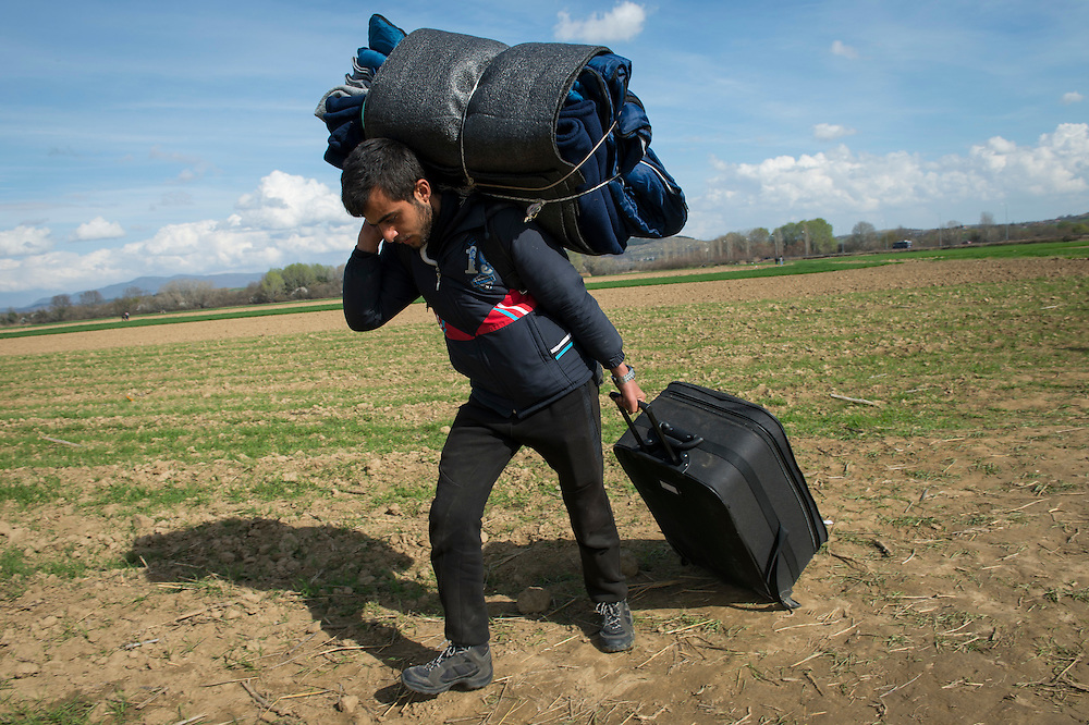 March 3, 2016, Idomeni, Greece. Refugees from Syria and Irak walk to the Idomeni border crossing in Greece. 12.000 refugees are stuck here  after Macedonia closed the border.  New arrivals come in every day. (Steven Wassenaar/Polaris)