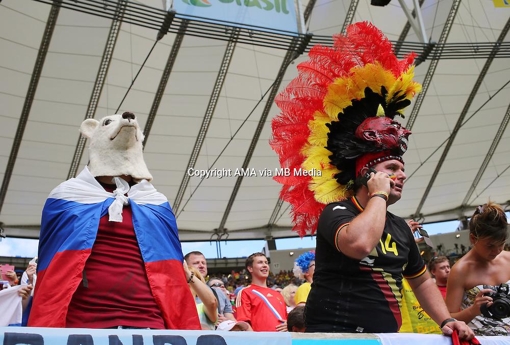A fan of Russia next to a fan of Belgium