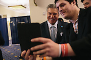 Al Cardenas, the chair of the American Conservative Union, takes a selfie with Josh Smith, from Toledo Ohio, during the the final day of the Conservative Political Action Conference (CPAC) at the Gaylord National Resort & Convention Center in National Harbor, Md.